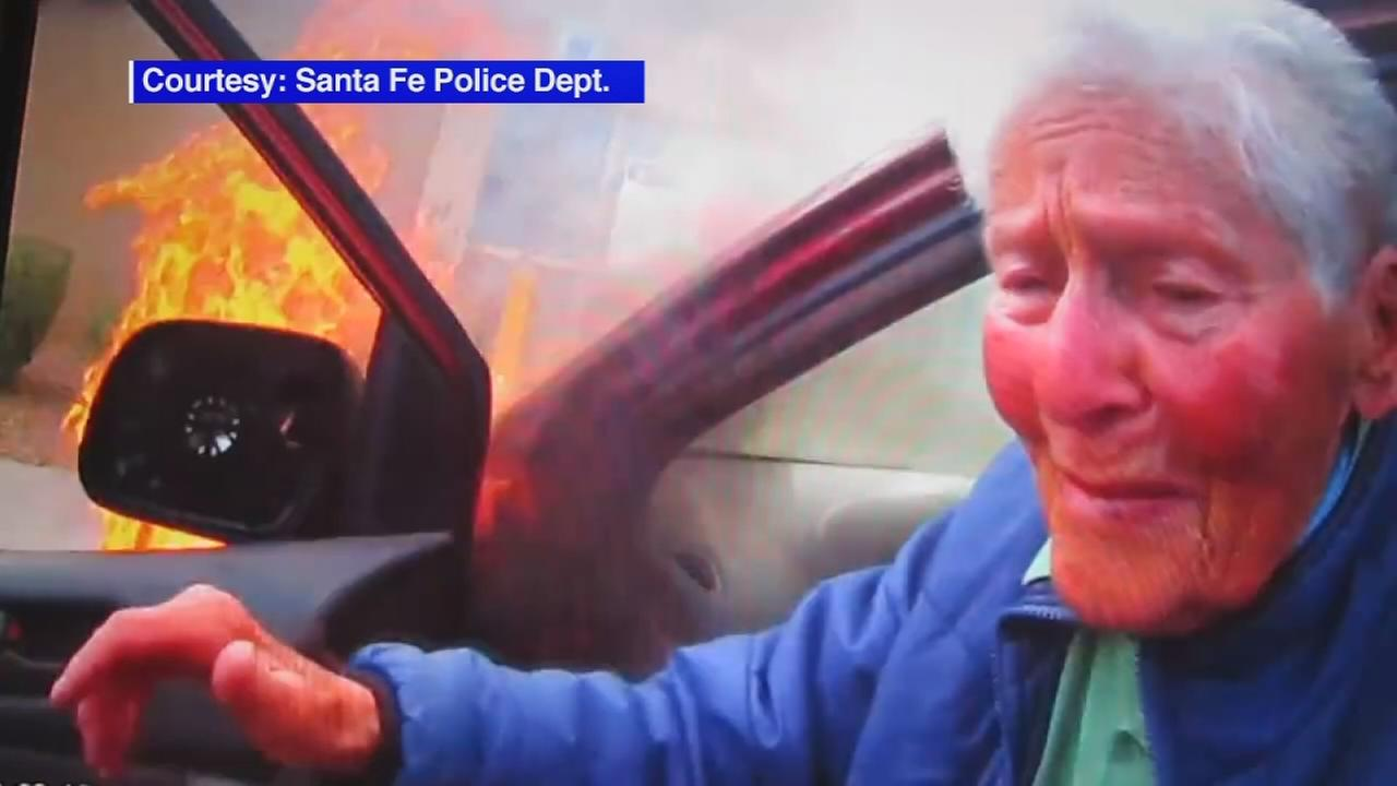 Officer rescues elderly woman from burning car