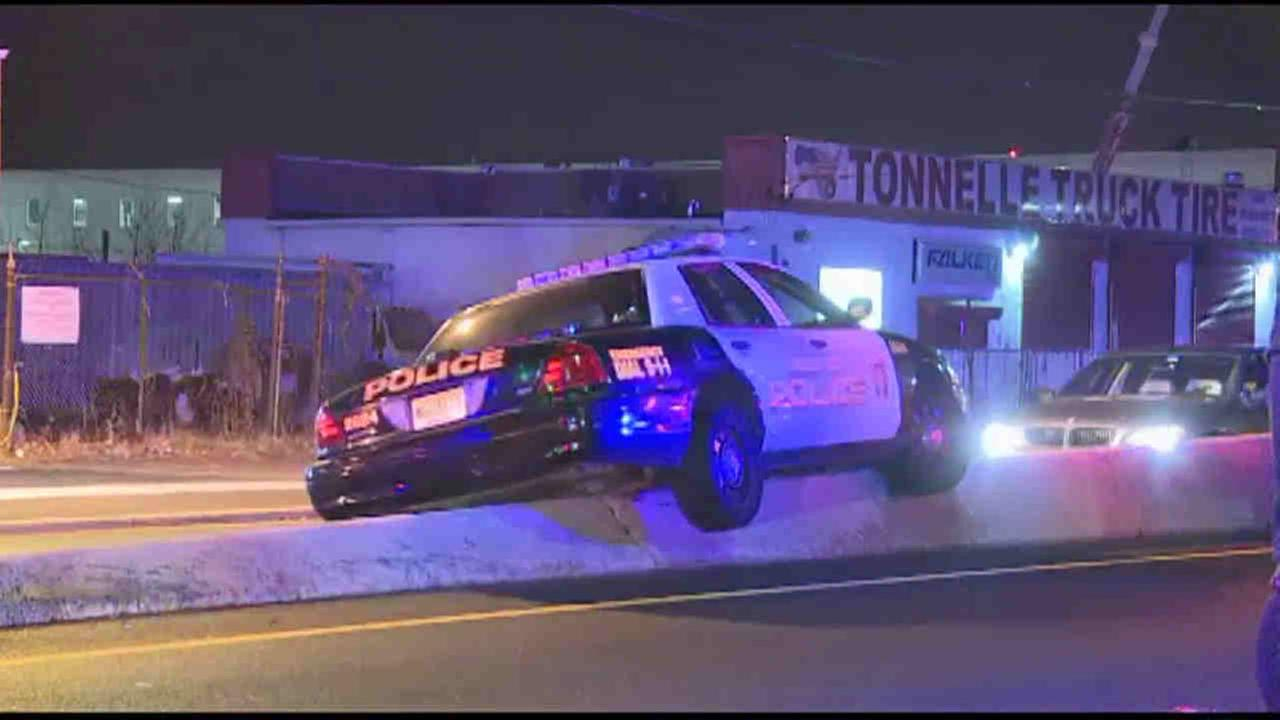 A Jersey City police cruiser attempting to pull over a suspect crashed into another vehicle.