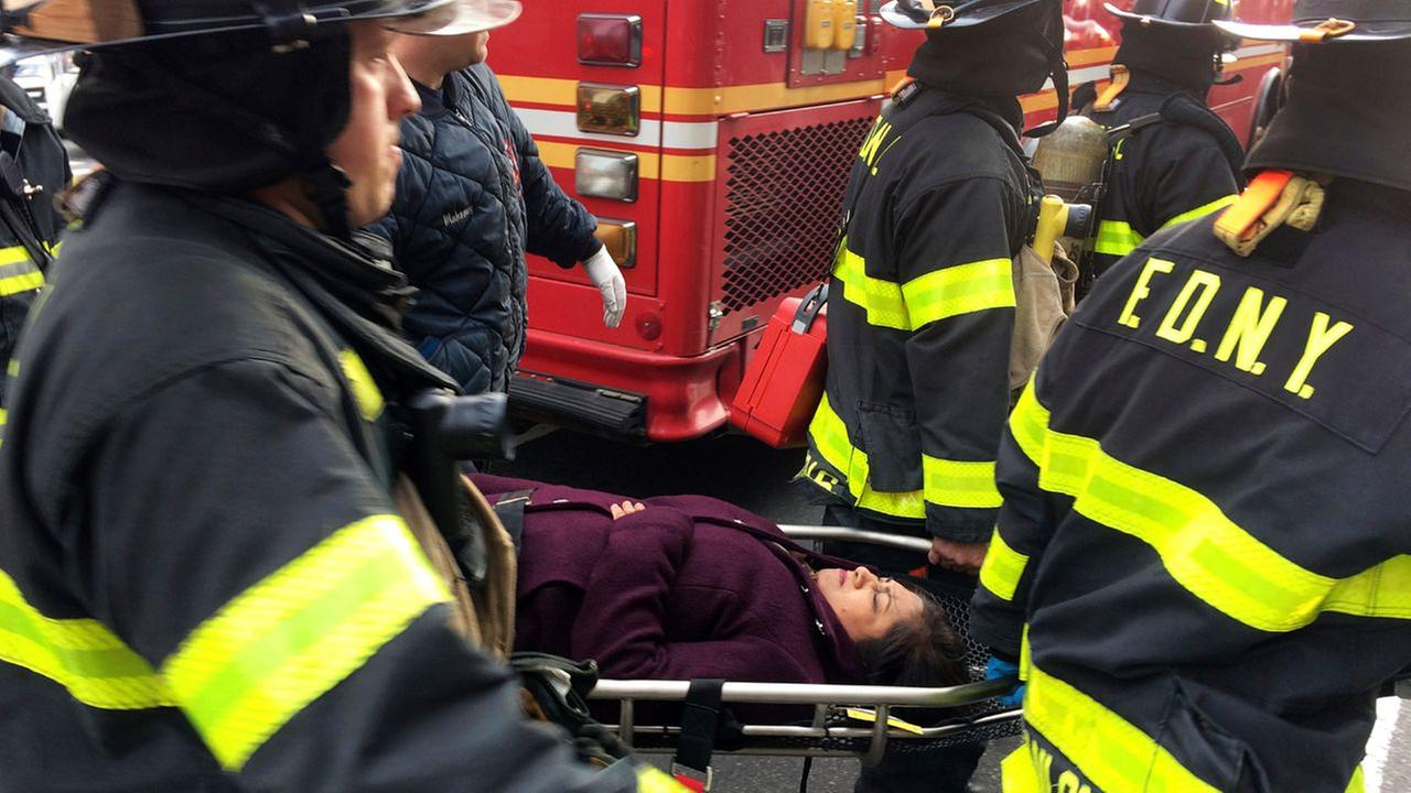 An injured passenger, after a Long Island Rail Road commuter train either hit something or derailed, is taken from the Atlantic Terminal, in the Brooklyn borough of New York.