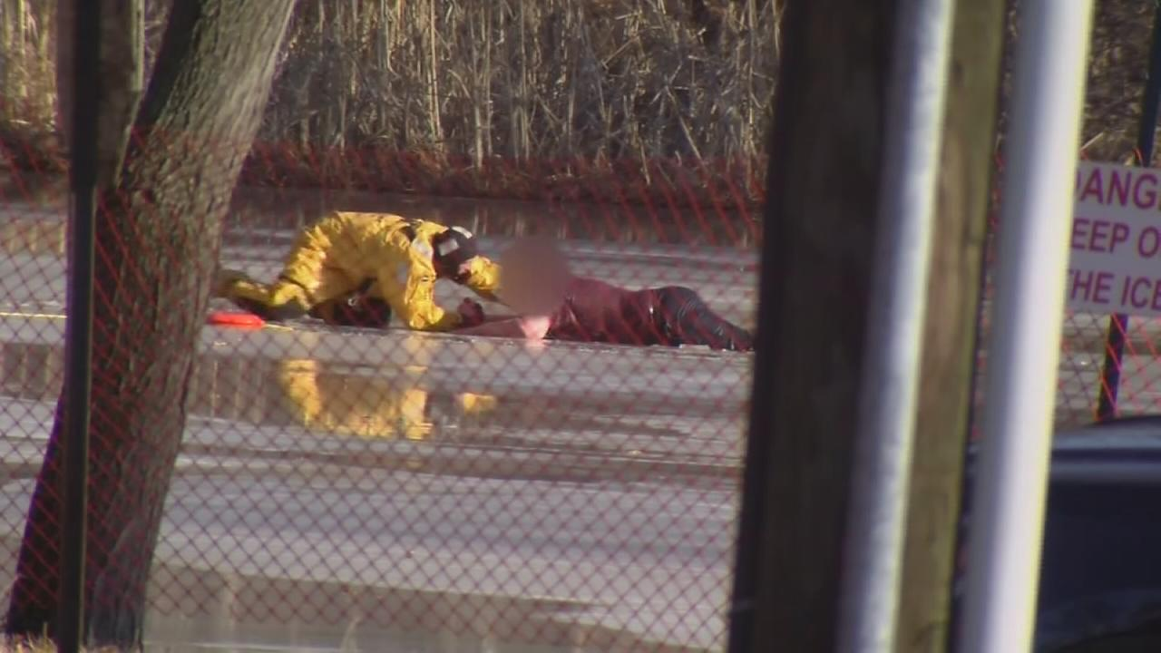 Teen rescued after falling through ice