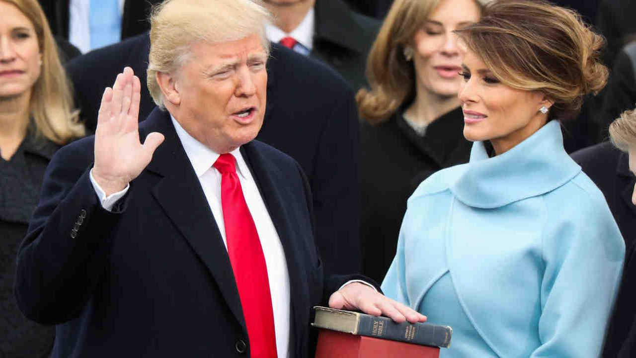Donald Trump is sworn in as the 45th president of the United States as Melania Trump looks on during the 58th Presidential Inauguration at the U.S. Capitol in Washington, Friday.