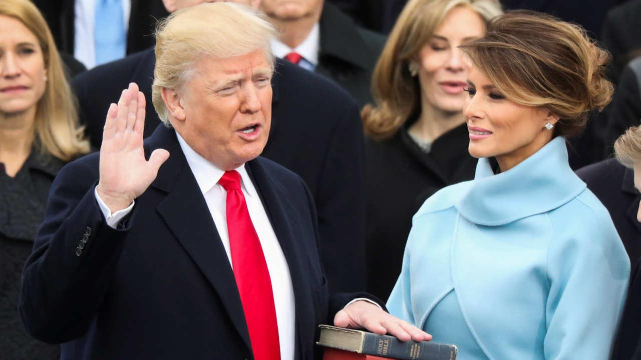 Donald Trump is sworn in as the 45th president of the United States as Melania Trump looks on during the 58th Presidential Inauguration at the U.S. Capitol in Washington.