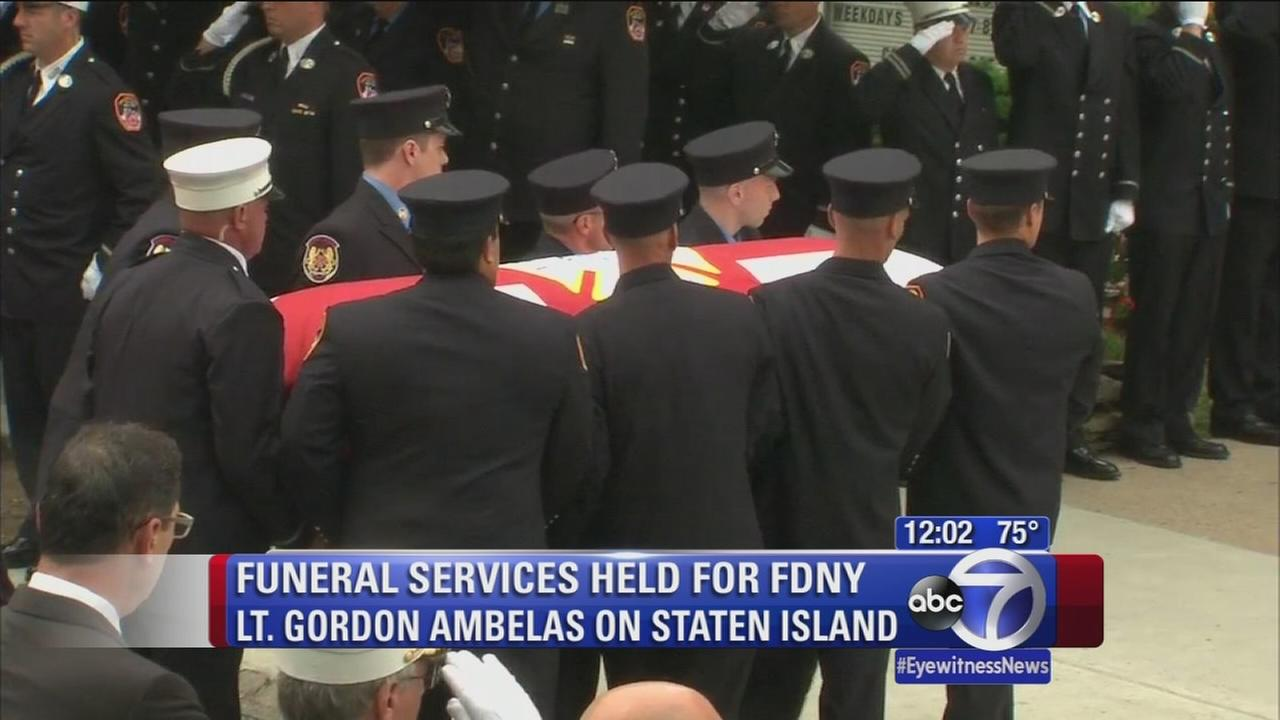 Crowds mourn New York City firefighter