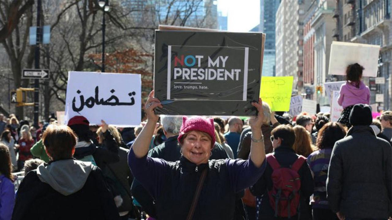 Ginger VonHolden, of Florida, join in New Yorks Not My Presidents Day rally on Monday.