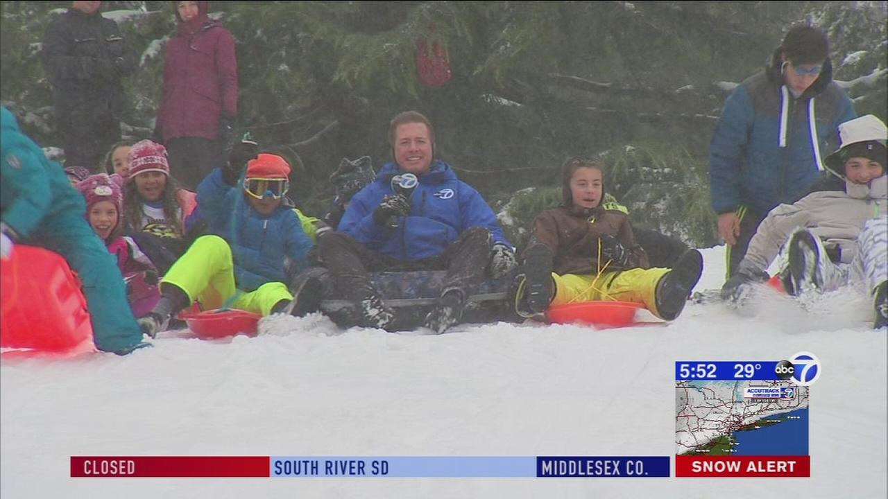 Families enjoy sledding at Central Park