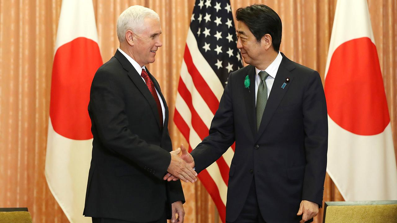 Japanese Prime Minister Shinzo Abe, right, and U.S. Vice President Mike Pence shake hands prior to a luncheon. (AP Photo/Eugene Hoshiko)