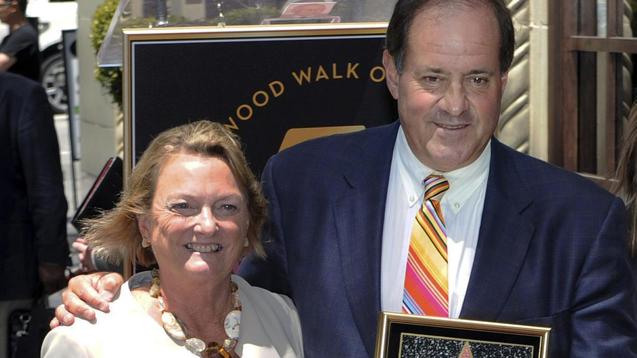 In this May 24, 2010, photo provided by ESPN, sportscaster Chris Berman stands with his wife, Katherine, upon receiving his star on the Hollywood Walk of Fame in Los Angeles.
