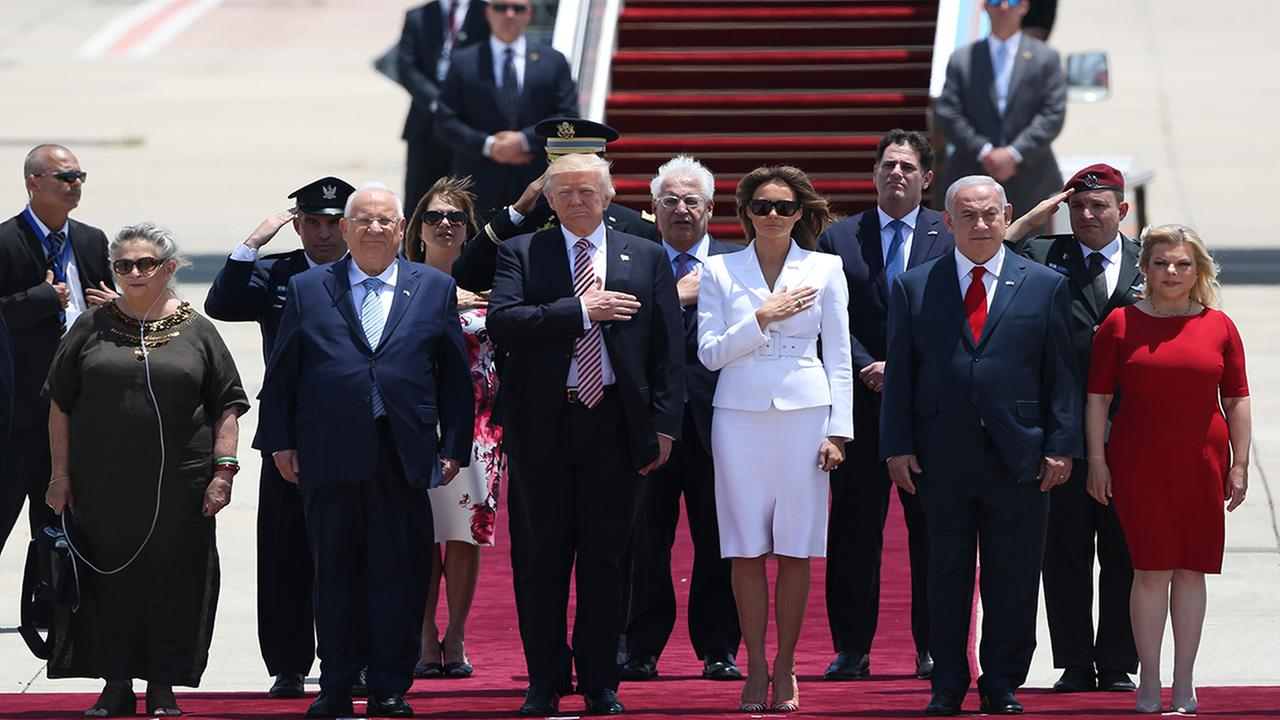 President Donald Trump and his wife Melania, center, stand in attention during welcome ceremony accompany by the Israeli President Rueben Rivlin and his wife Nechama, on the left.