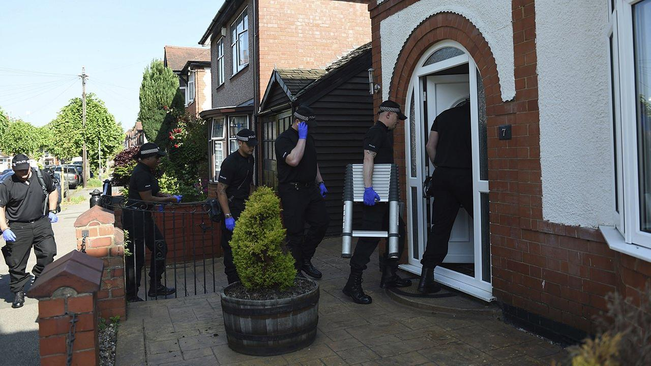 Police at the scene at an address in Nuneaton, England Thursday where they arrested a seventh suspect in the investigation into the Manchester Arena bombing.