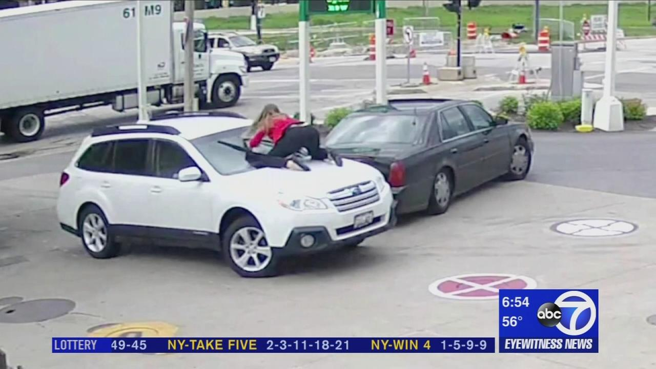 Woman jumps on car to prevent carjacking
