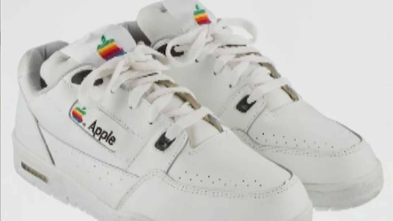 A pair of vintage Apple sneakers are up for auction.