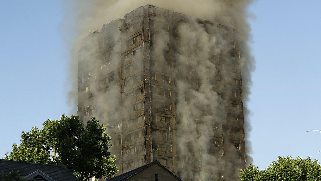 Smoke rises from a building on fire in London, Wednesday. The fire burned for more than three hours and stretched from the second to the 27th floor of the building.