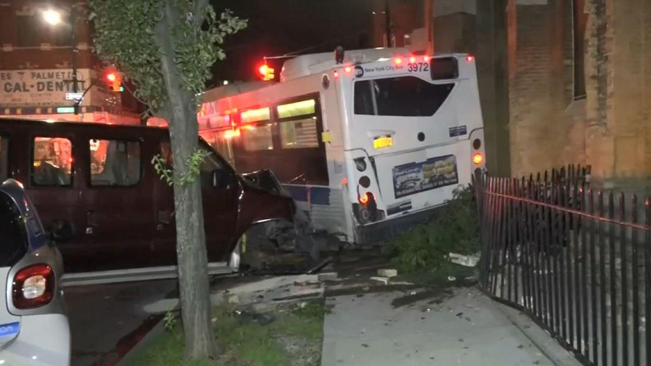 An empty MTA city bus rolled down the block in Brooklyn.