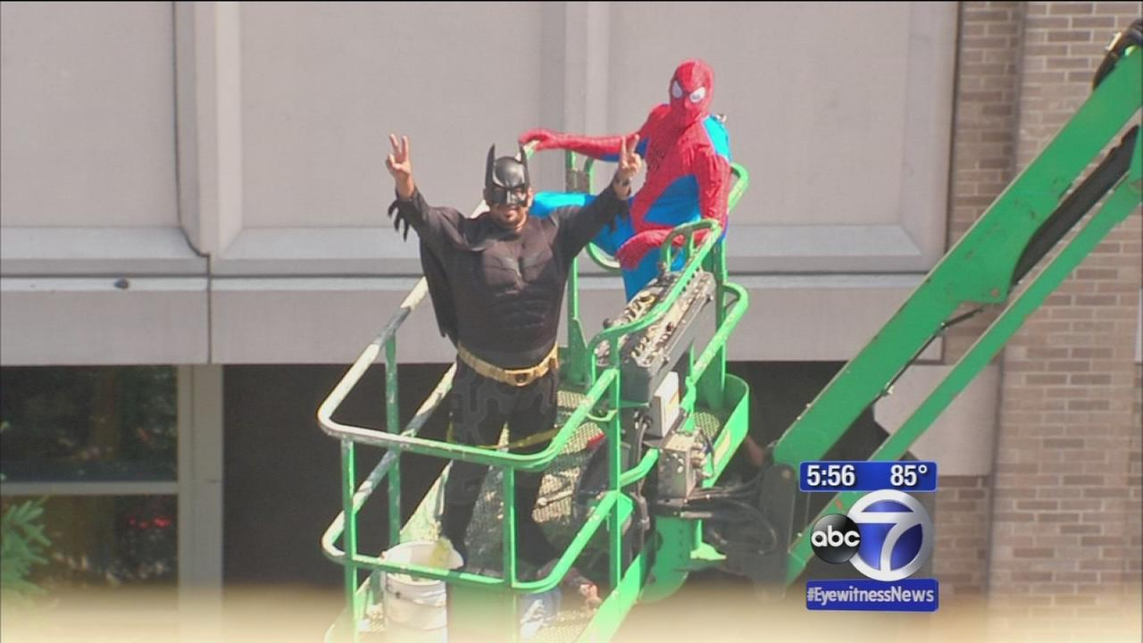 Superheroes visit sick children at local hospital