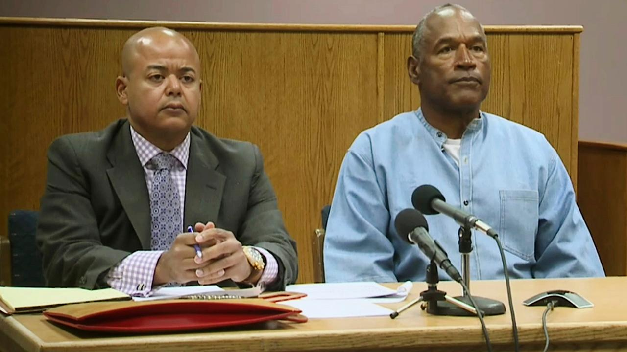 O.J. Simpson appears with his attorney, Malcolm LaVergne, left, via video for his parole hearing at the Lovelock Correctional Center in Lovelock, Nev., on Thursday, July 20, 2017.