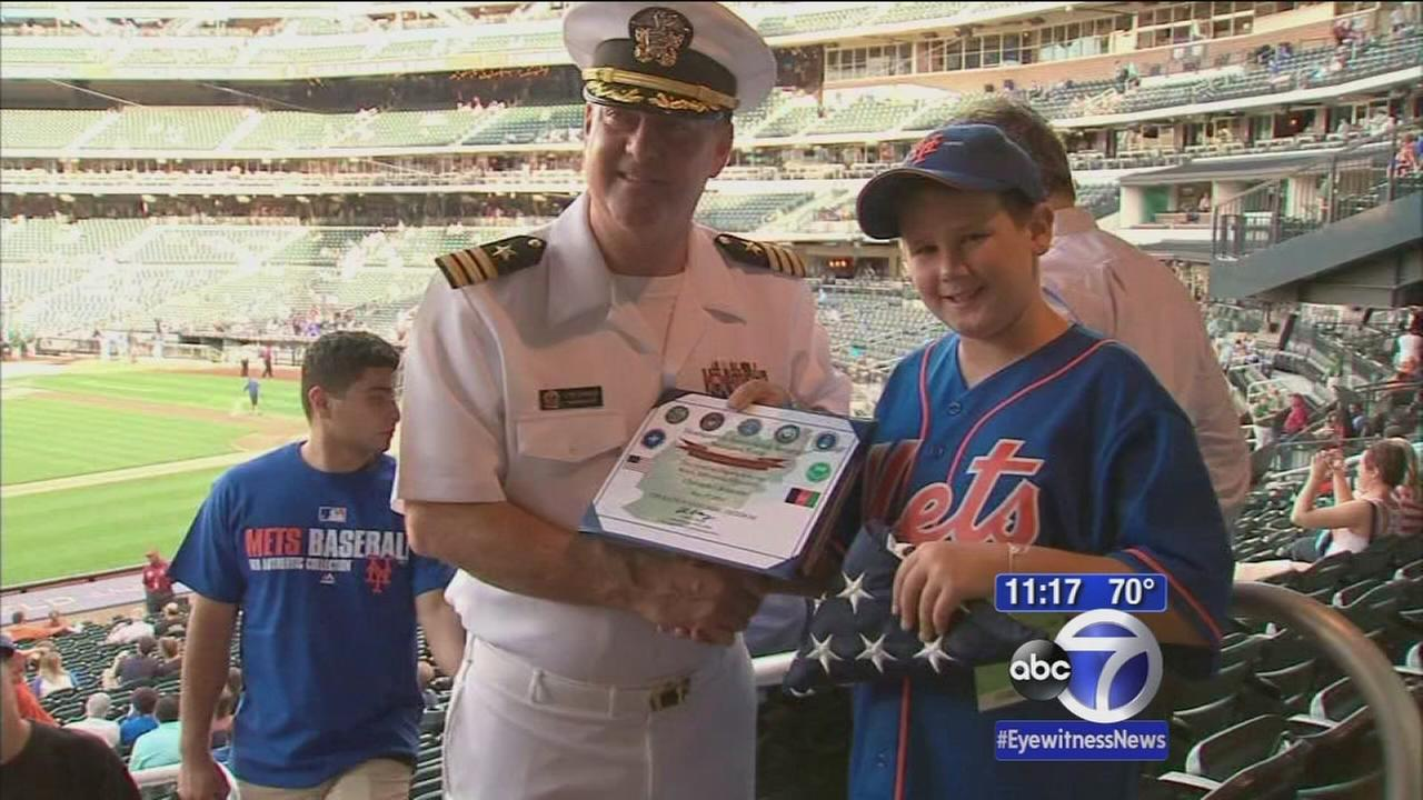 Young hero who saved neighbors from fire honored by Mets
