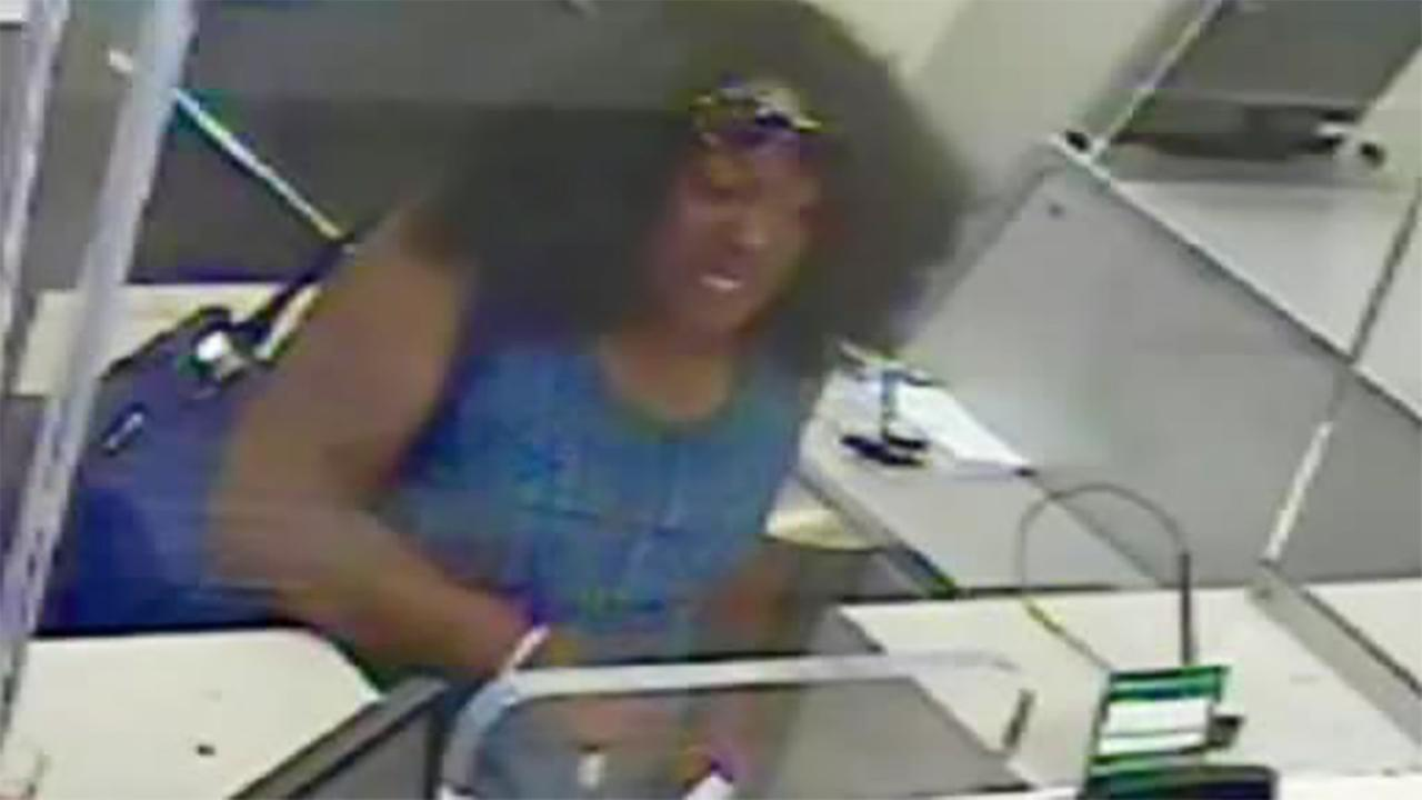 Image result for Search on for man who dressed in women's clothing in Greenwich Village bank robbery
