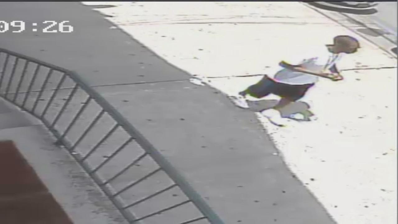 Suspect grabs necklace off woman at bus stop
