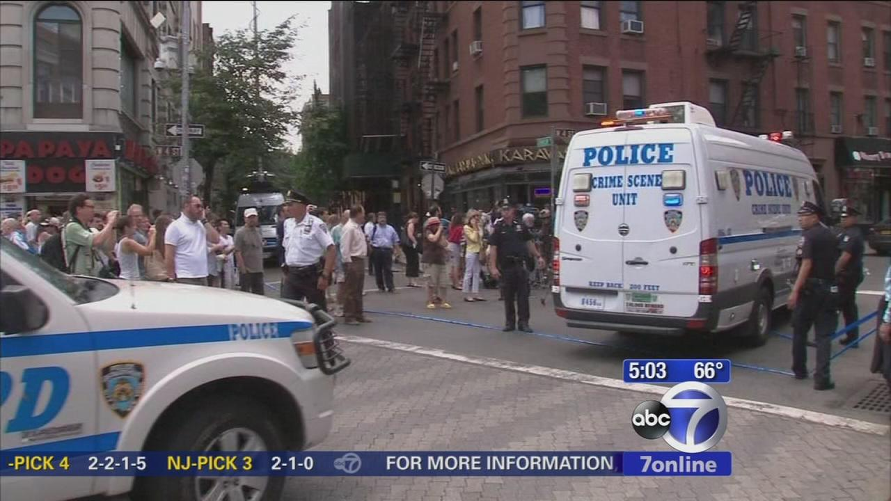 Detective wounded in NYC shootout improving