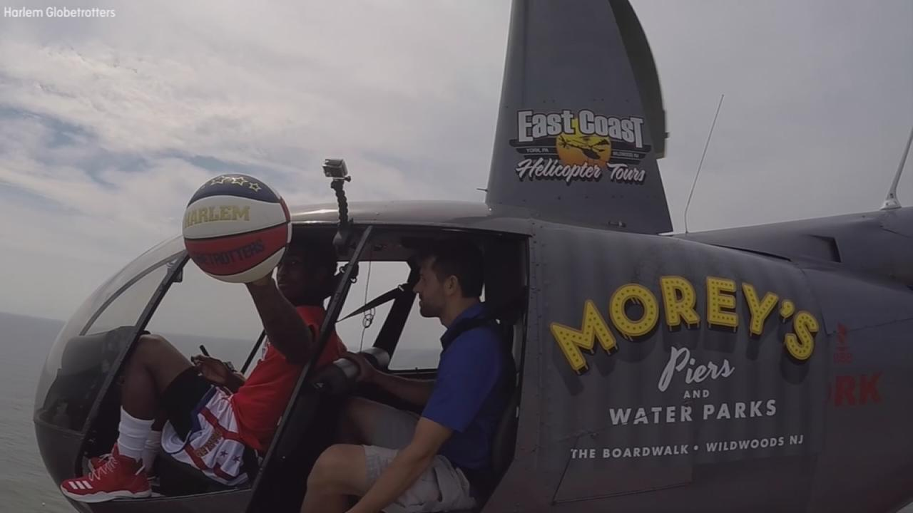 Globetrotter sinks record-breaking shot from helicopter