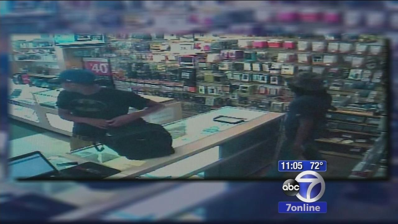Suspects wanted for robbing Midtown cell phone store