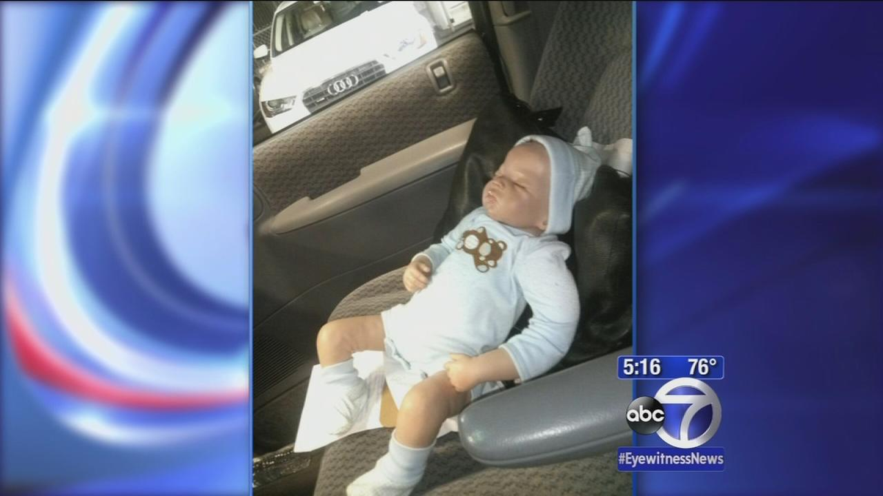 Man breaks into a car to save fake baby