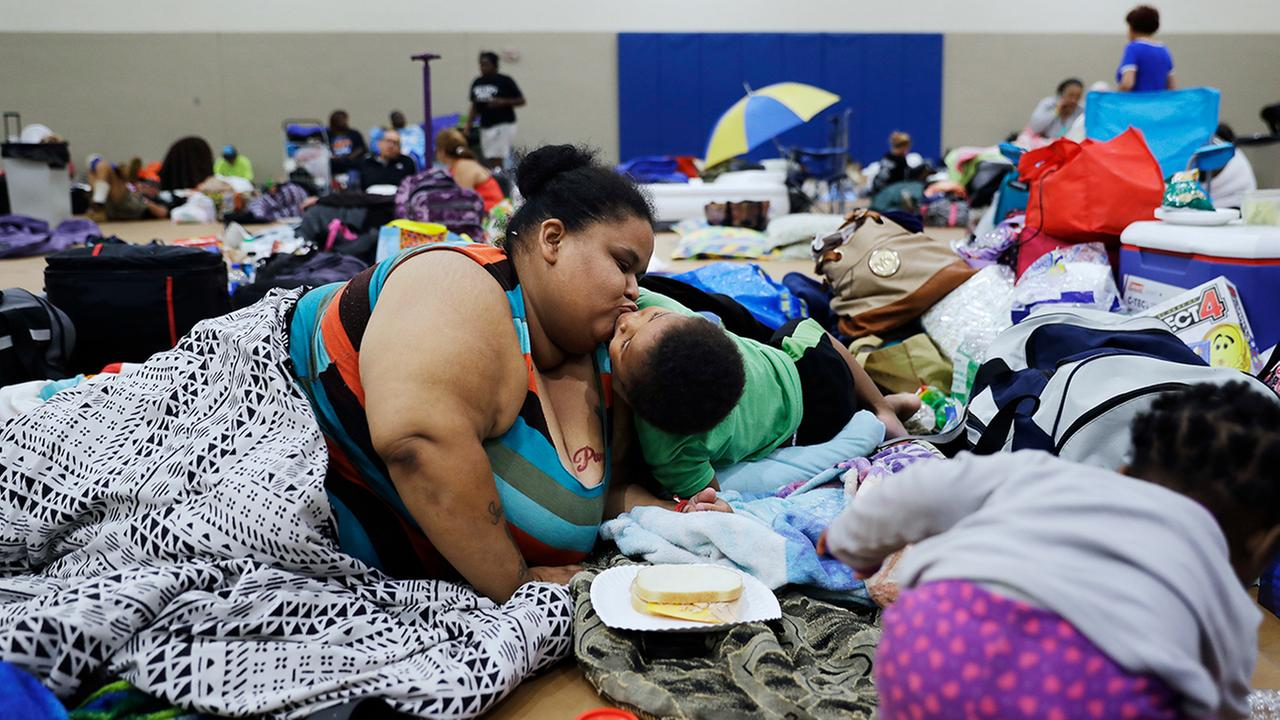 Annette Davis kisses her son Darius, 3, while staying at a shelter in Miami after evacuating from their home in Florida City, Fla., ahead of Hurricane Irma (AP Photo/David Goldman)