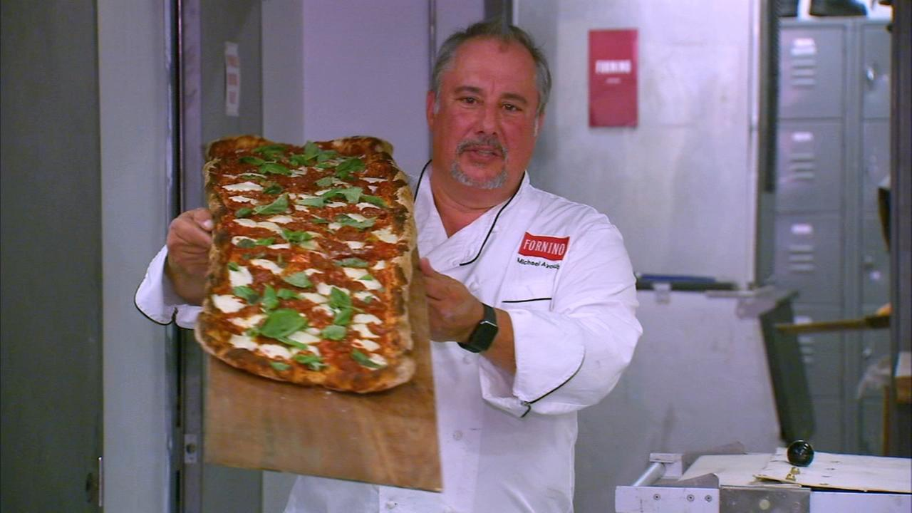 its a 6-foot long pizza
