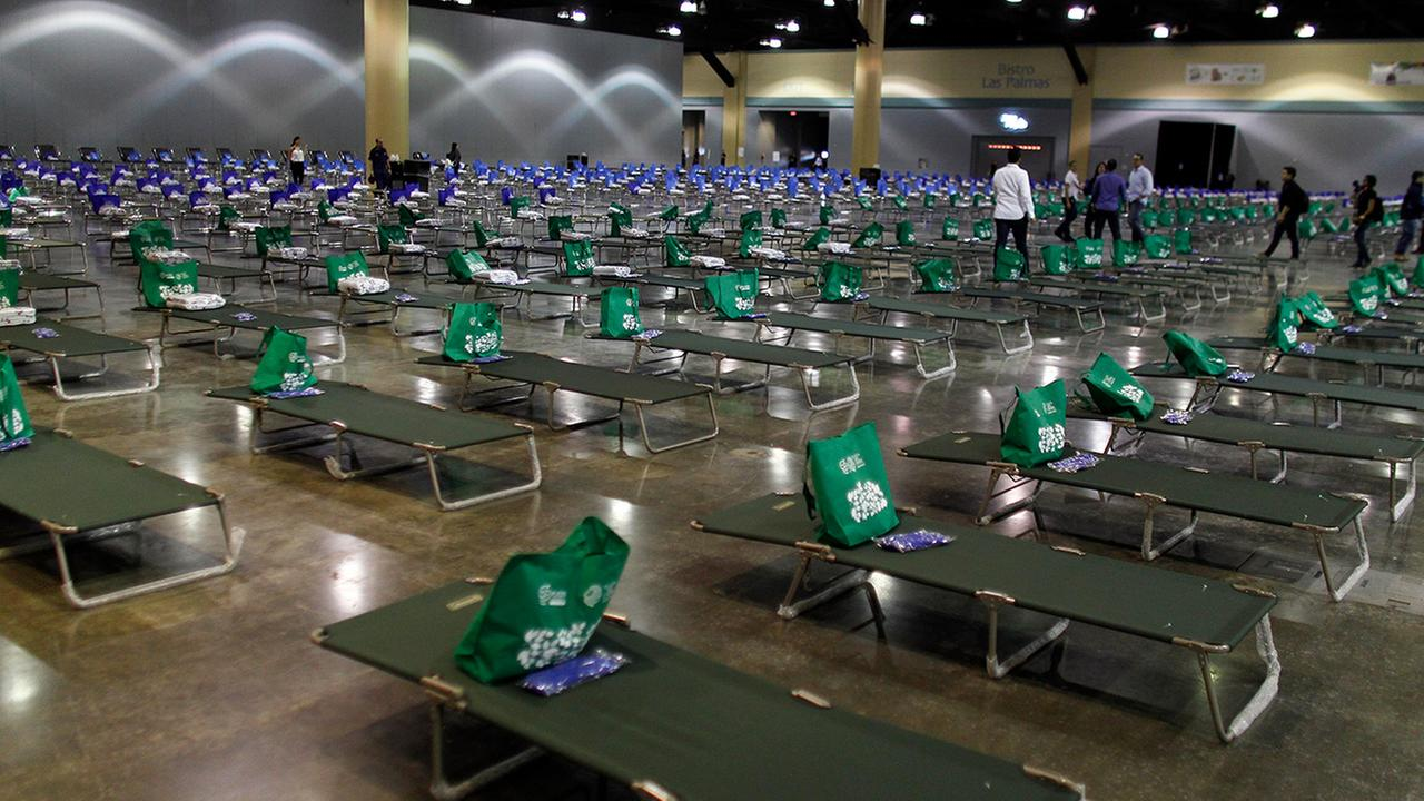 Cots are set up in a convention center transformed into a shelter for victims of Hurricane Irma, in San Juan, Puerto Rico, Thursday, Sept. 14, 2017.