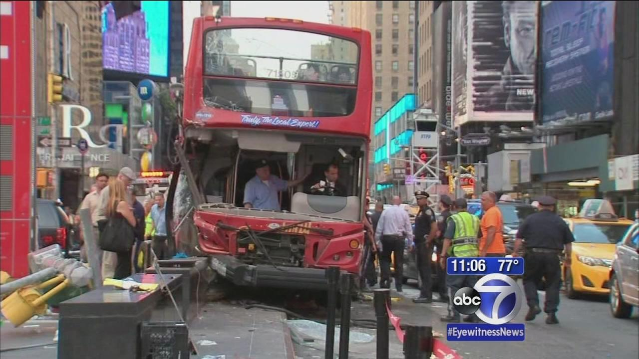 Double-decker tour buses collide in Times Square