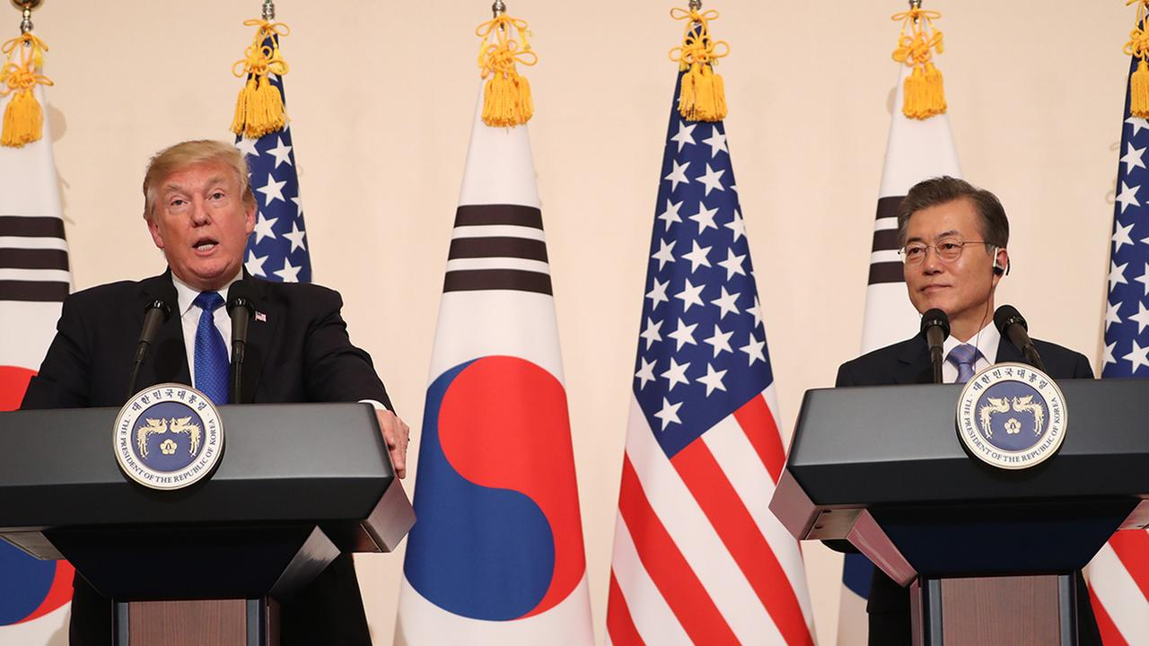 President Donald Trump, left, speaks as South Korean President Moon Jae-in looks on in a joint news conference at the Blue House in Seoul, South Korea, Tuesday, Nov. 7, 2017.