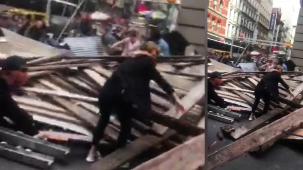 Raw video: Bystands help with rescues after SoHo scaffolding collapse