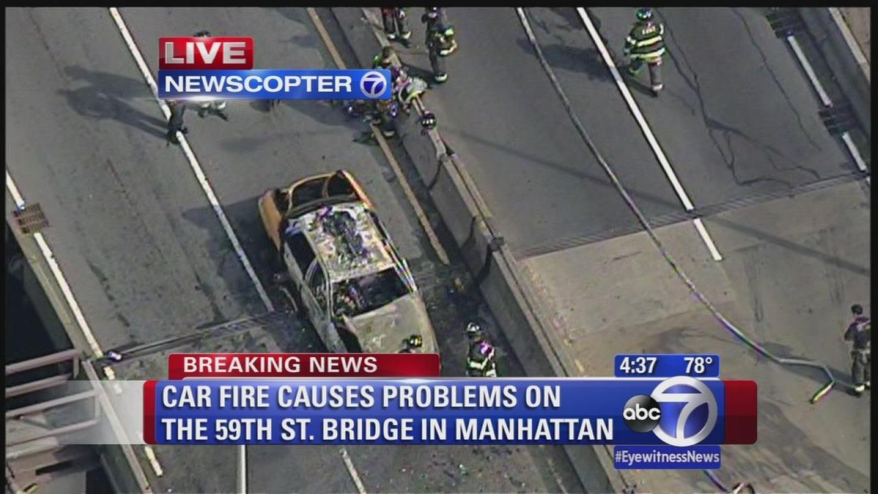 Car fire on 59th Street Bridge causing traffic problems