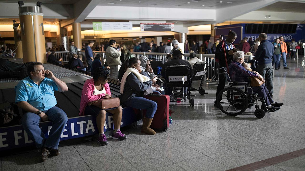 assengers wait after the lights went out at Hartfield-Jackson Atlanta International Airport, Sunday, Dec. 17, 2017, in Atlanta.