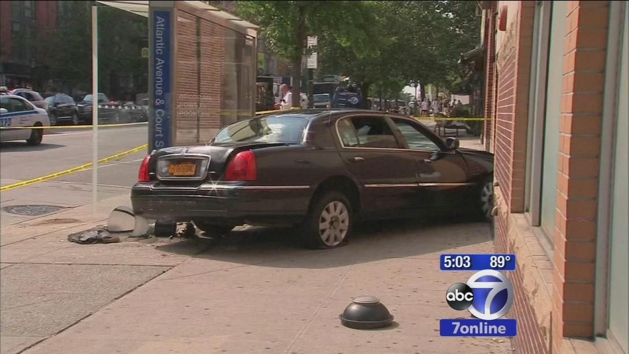 Woman critically injured when livery cab jumps curb