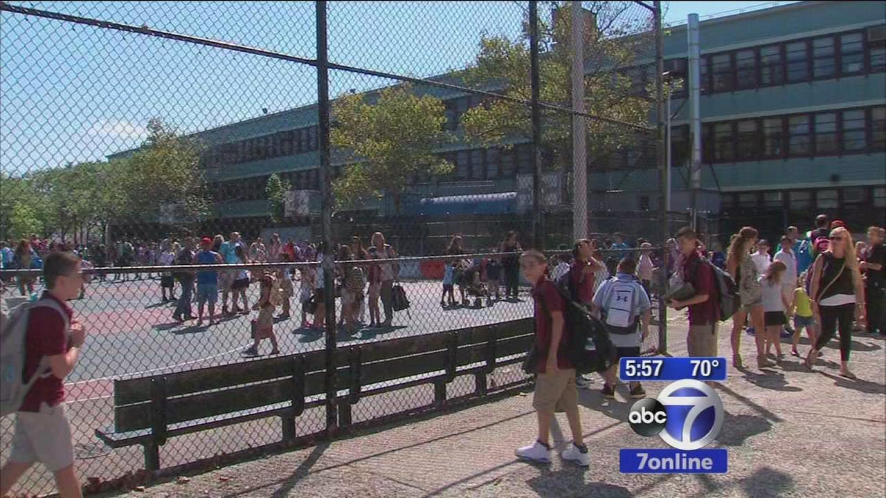 Parents push for new smoke alarms at Queens school