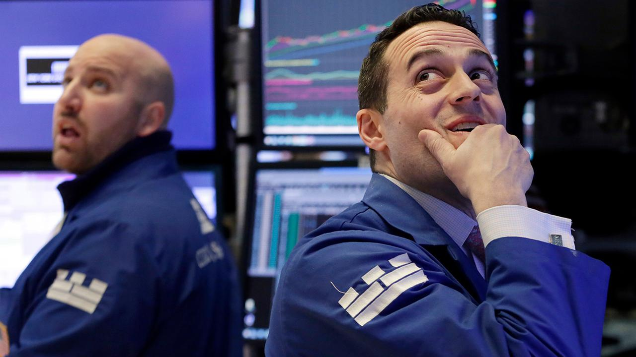 FILE - Specialists John Parisi, left, and Michael Gagliano work on the floor of the New York Stock Exchange, Monday, Feb. 5, 2018.