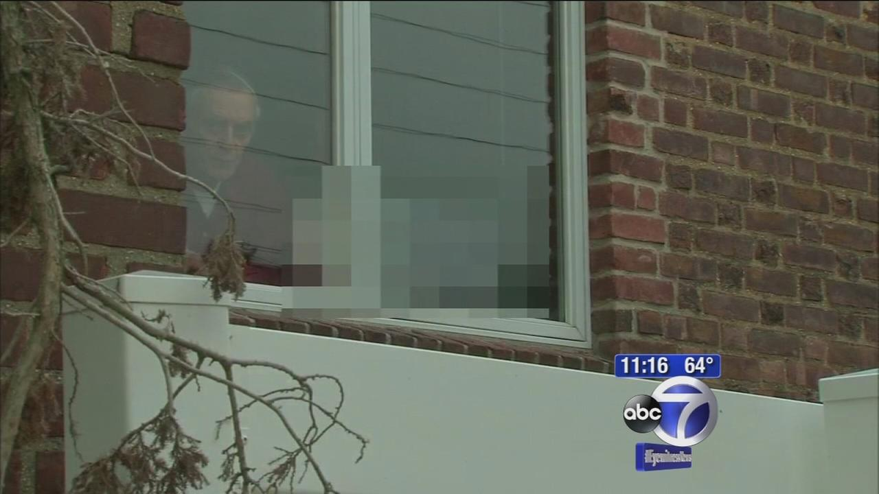 Nasty neighbor hangs up porn in windows