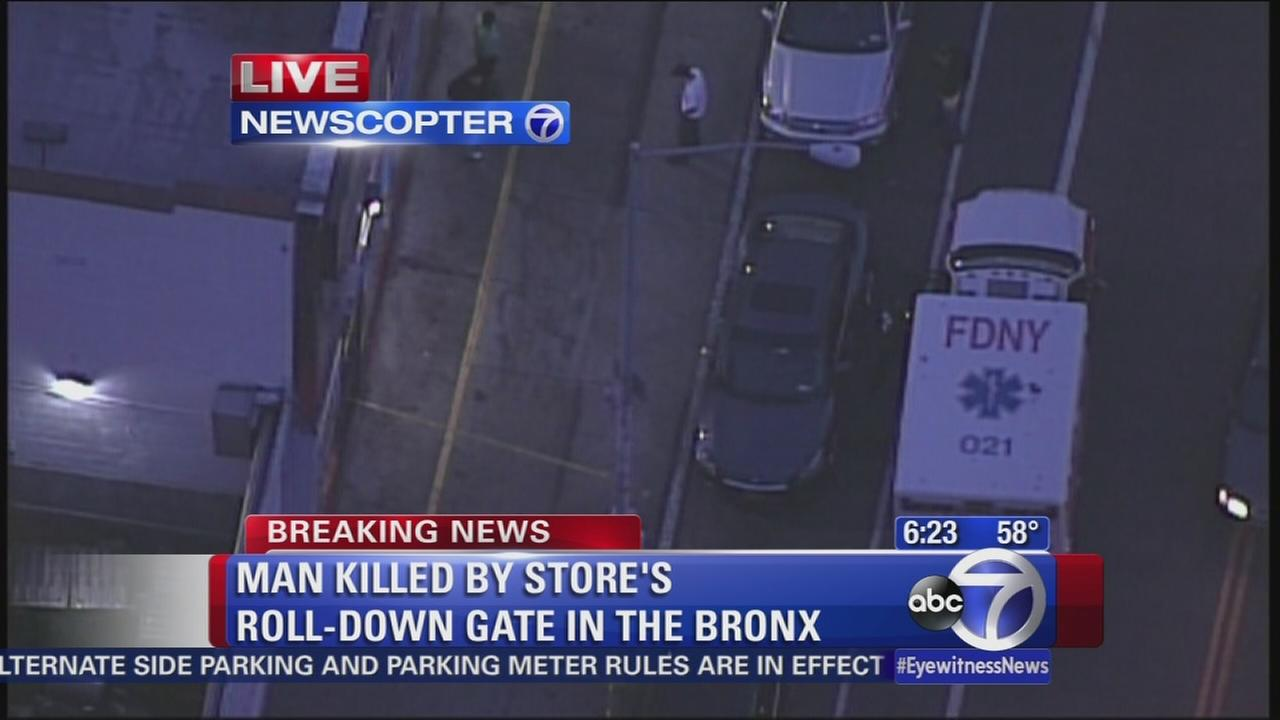 Man crushed by buisiness roll-gate in Bronx