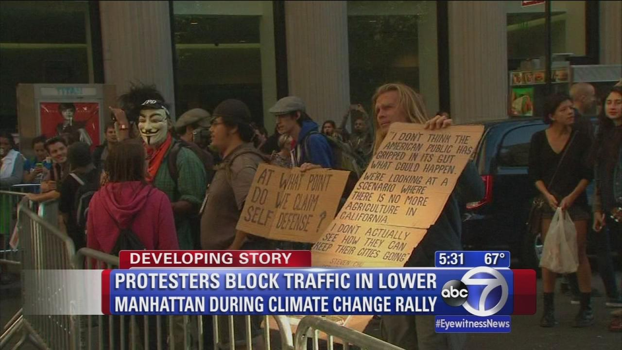 Protesters block traffic in Lower Manhattan during climate change rally