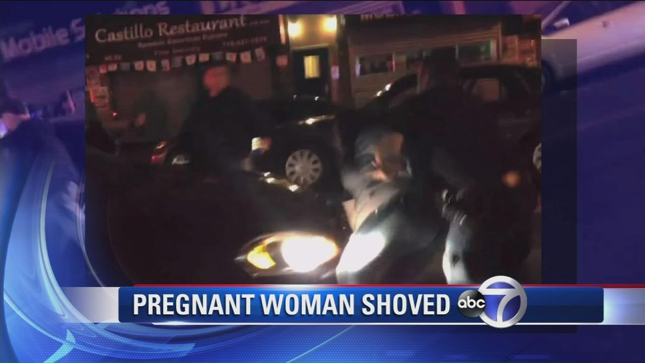 Pregnant woman shoved to ground by police