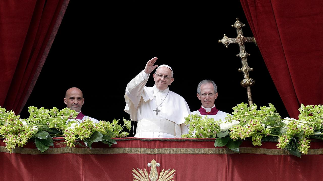 Pope Francis delivers the Urbi et Orbi (to the city and to the world) blessing at the end of Easter Sunday Mass in St. Peters Square at the Vatican. (AP Photo/Andrew Medichini)