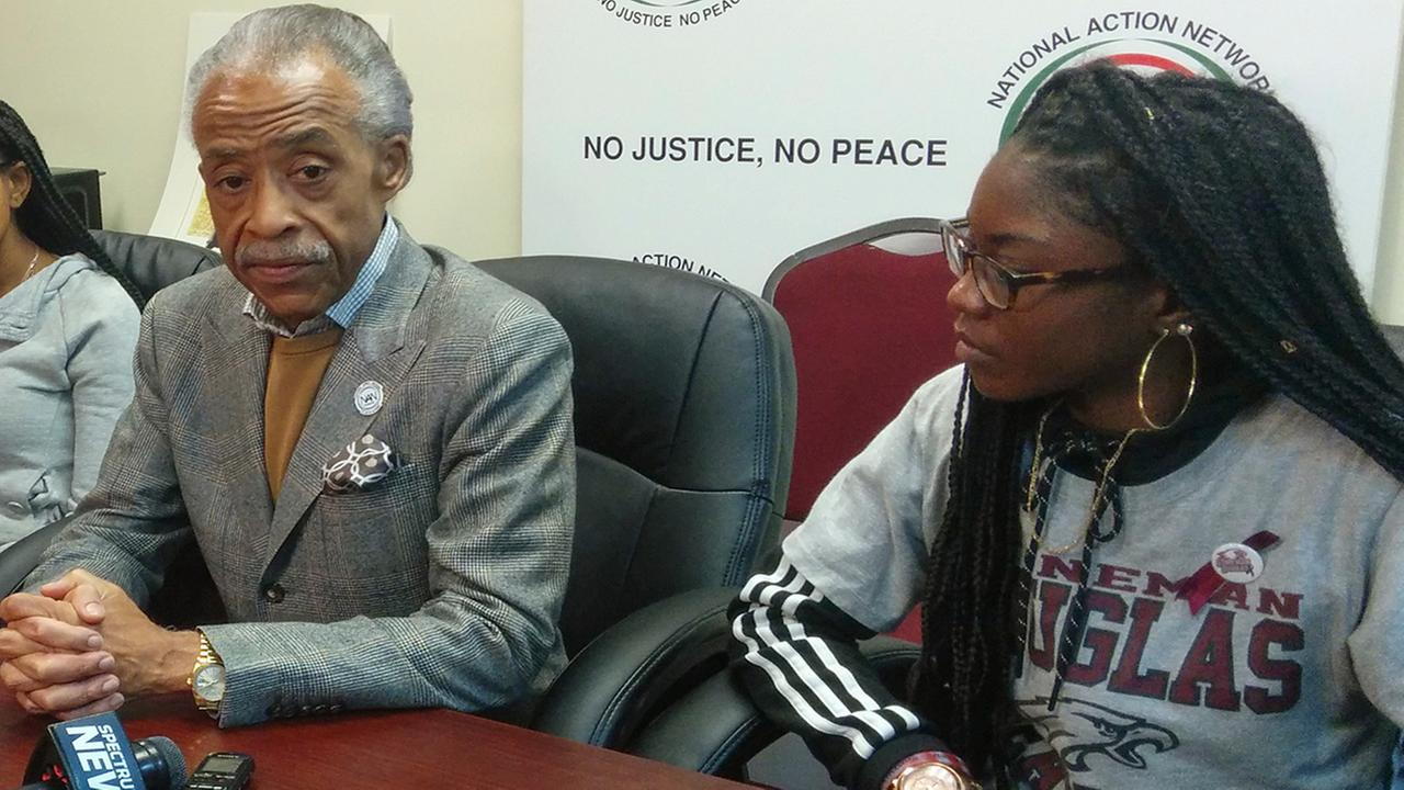 The Rev. Al Sharpton, left, is joined by Aalayah Eastmond, a junior at Stoneman Douglas High School, during the National Action Network meeting, (AP Photo/Julie Walker)