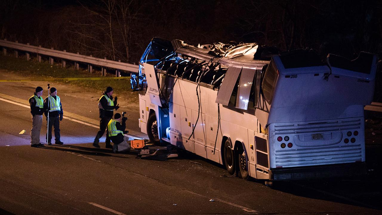 A bus that was carrying teenage passengers sits on the side of a highway after it hit an overpass on the Southern State Parkway in Lakeview, N.Y.(AP Photo/Kevin Hagen)