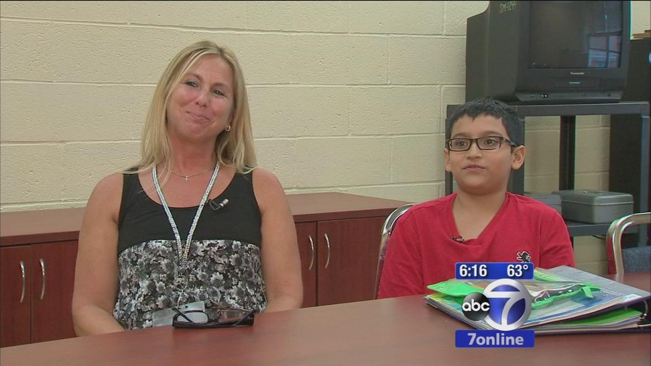 School aide comes to rescue of choking student