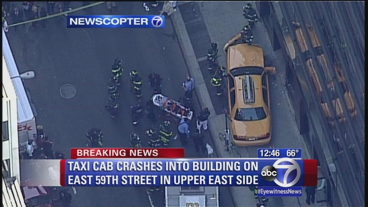 Taxi strikes pedestrian and building on Upper East Side