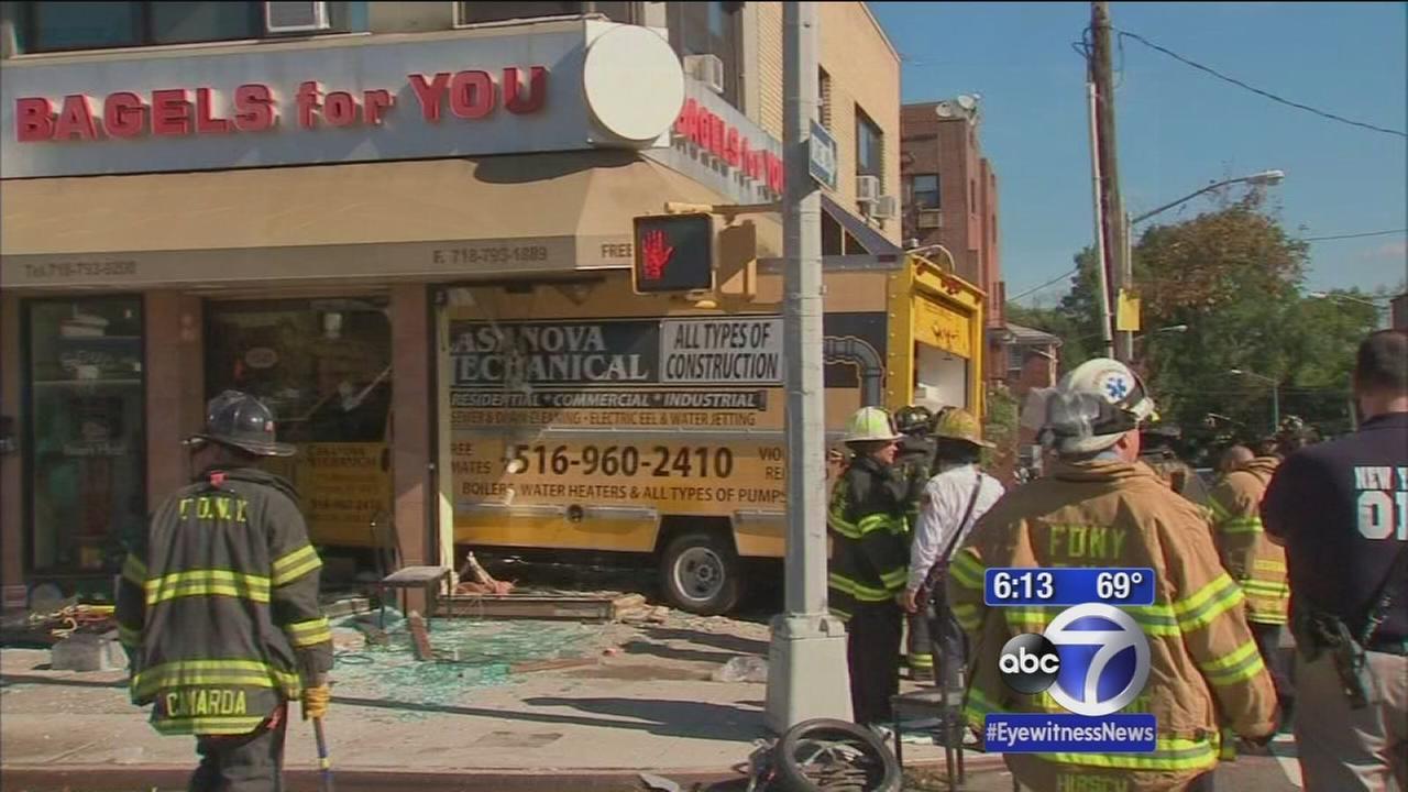 Truck crashes into bagel shop in Queens