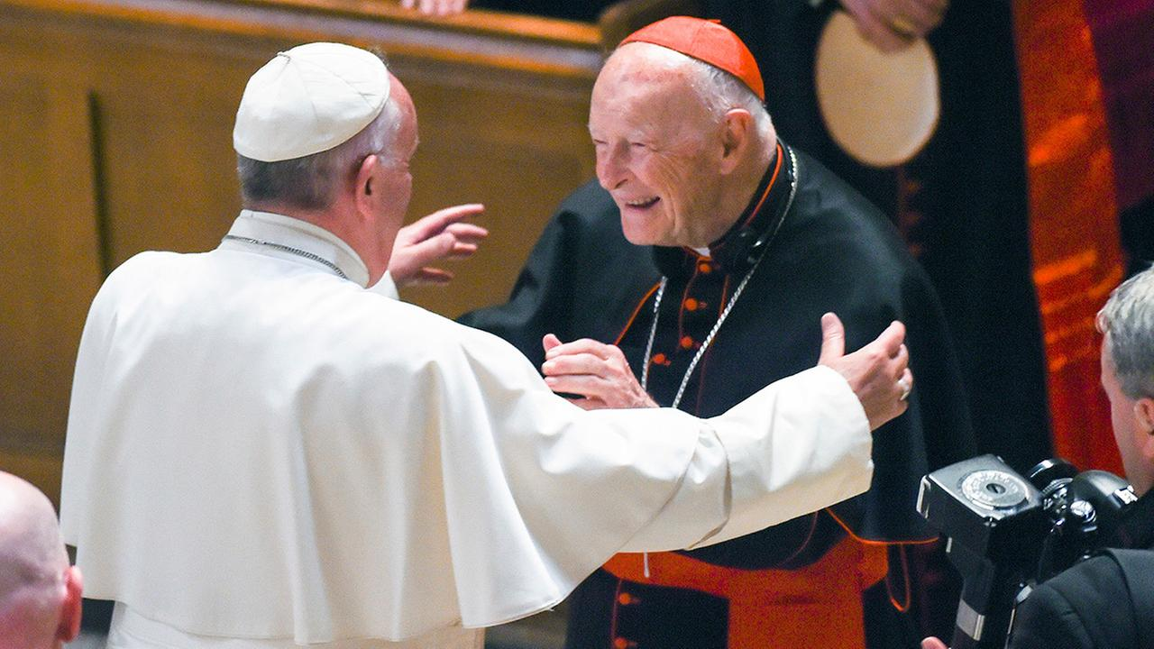 In this Sept. 23, 2015 file photo, Pope Francis reaches out to hug Cardinal Archbishop emeritus Theodore McCarrick at the Cathedral of St. Matthew the Apostle in Washington.