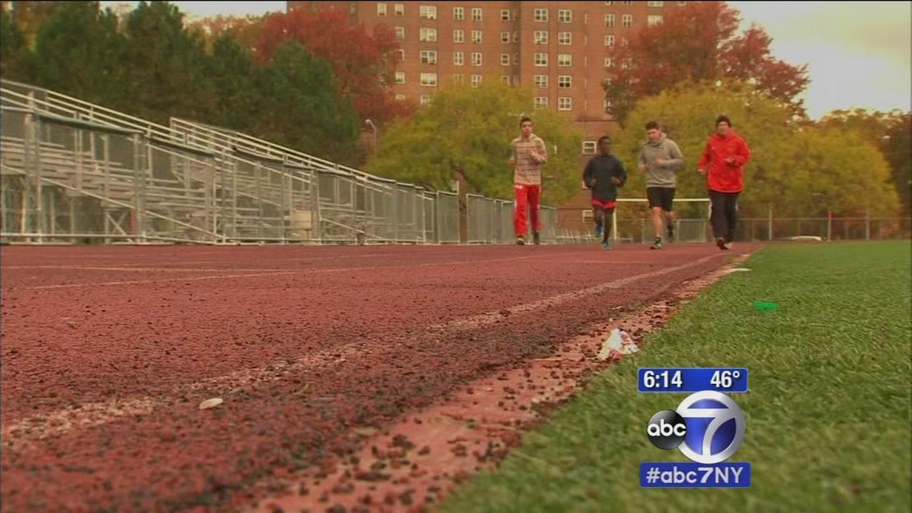 High school principal raises money for school by running 100 miles around track