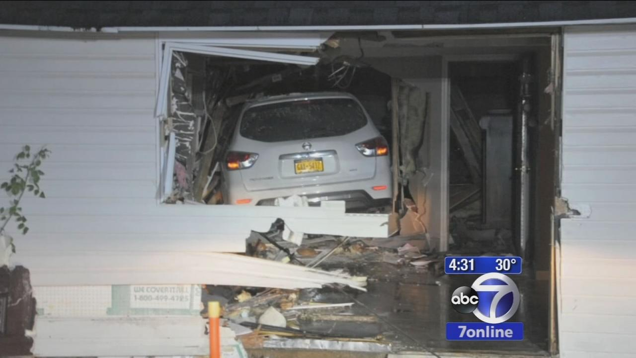 Car slams into house on Long Island